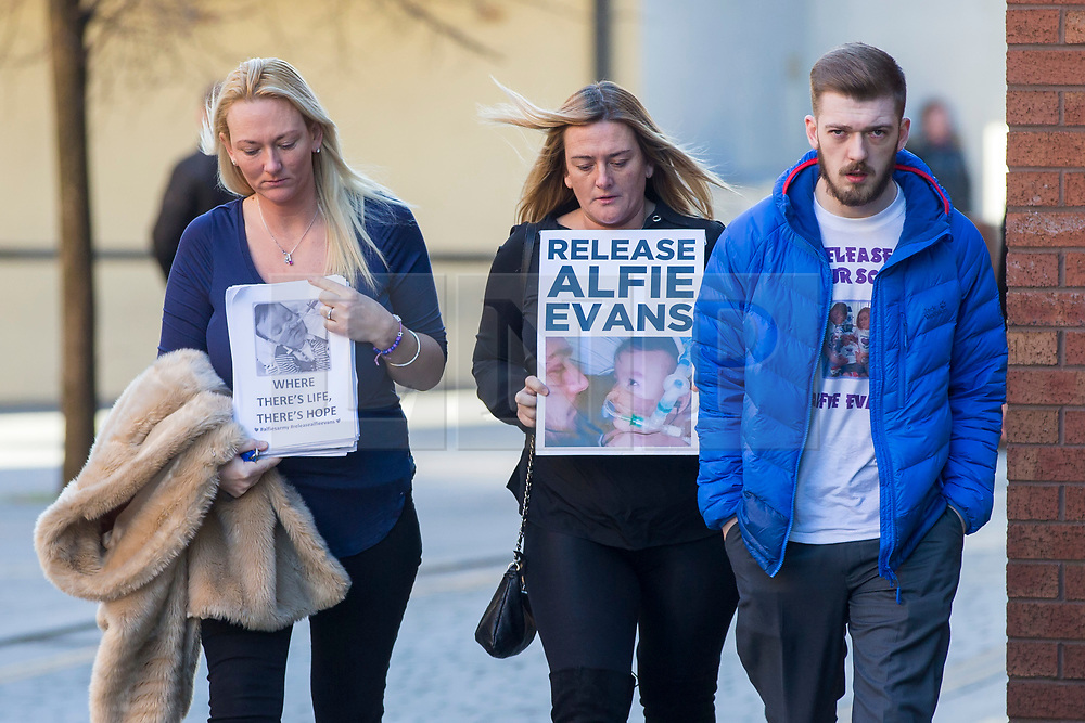 """DATE CORRECTION IMAGES SHOT TODAY © Licensed to London News Pictures. 07/02/2018. Liverpool, UK. Tom Evans, father of Alfie Evans arrives with supporters at Liverpool Civil & Family Court this morning. Tom Evans and Kate James from Liverpool are in dispute with medics looking after their son 19-month-old son Alfie Evans, at Alder Hey Children's Hospital in Liverpool. Alfie is in a """"semi-vegetative state"""" and had a degenerative neurological condition doctors have not definitively diagnosed. Specialists at Alder Hey say continuing life-support treatment is not in Alfie's best interests but the boy's parents want permission to fly their son to a hospital in Rome for possible diagnosis and treatment. Photo credit: Andrew McCaren/LNP"""
