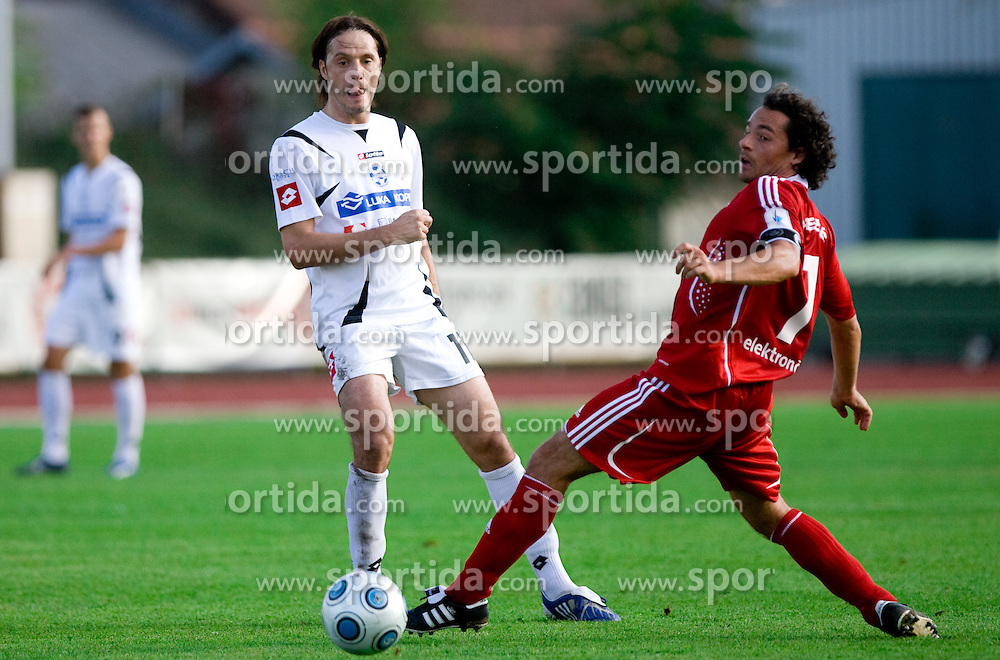 Miran Pavlin of Koper and Danijel Brezic of Interblock at the football match Interblock vs NK Luka Koper in 12th Round of Prva liga 2009 - 2010,  on October 03, 2009, in ZSD Ljubljana, Ljubljana, Slovenia. Luka Koper won 1:0.  (Photo by Vid Ponikvar / Sportida)