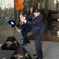 MACAU, CHINA - JUNE 01:  Businessmen James Packer smashes a Spanish guitar during the Hard Rock Hotel opening ceremony, as part of the acts of the opening of his and Lawrence Ho's 'City of Dreams' casino on June 1, 2009 in Cotai, Macau. The new 420,000 square foot casino, built on marshland 9km from Macao's traditional casino district but over the road from the world's largest casino 'Sands Venetian Macao', hopes to lure customers to the new casino area. 'City of Dreams' will offer over 500 gambling tables alongside its 3 hotels, a shopping mall and digital fish which swim in an electronic aquarium know as 'The Bubble'.  Photo by Victor Fraile / studioEAST