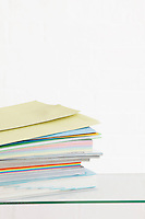Stack of coloured stationery studio shot