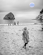 Children entertained by large bubbles on the Pacific City, Oregon beach, next to the Cape Kiwanda State Natural Area