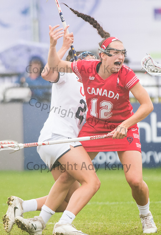 Canada's Megan Kinna(12) gets tangled with USA's Marie McCool at the 2017 FIL Rathbones Women's Lacrosse World Cup at Surrey Sports Park, Guilford, Surrey, UK, 15th July 2017