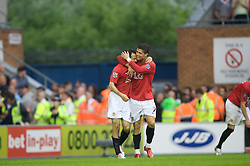 WIGAN, ENGLAND - Sunday, May 11, 2008: Manchester United's Ryan Giggs celebrates scoring the second goal against Wigan Athletic with fellow goalscorer Cristiano Ronaldo during the final Premiership match of the season at the JJB Stadium. (Photo by David Rawcliffe/Propaganda)