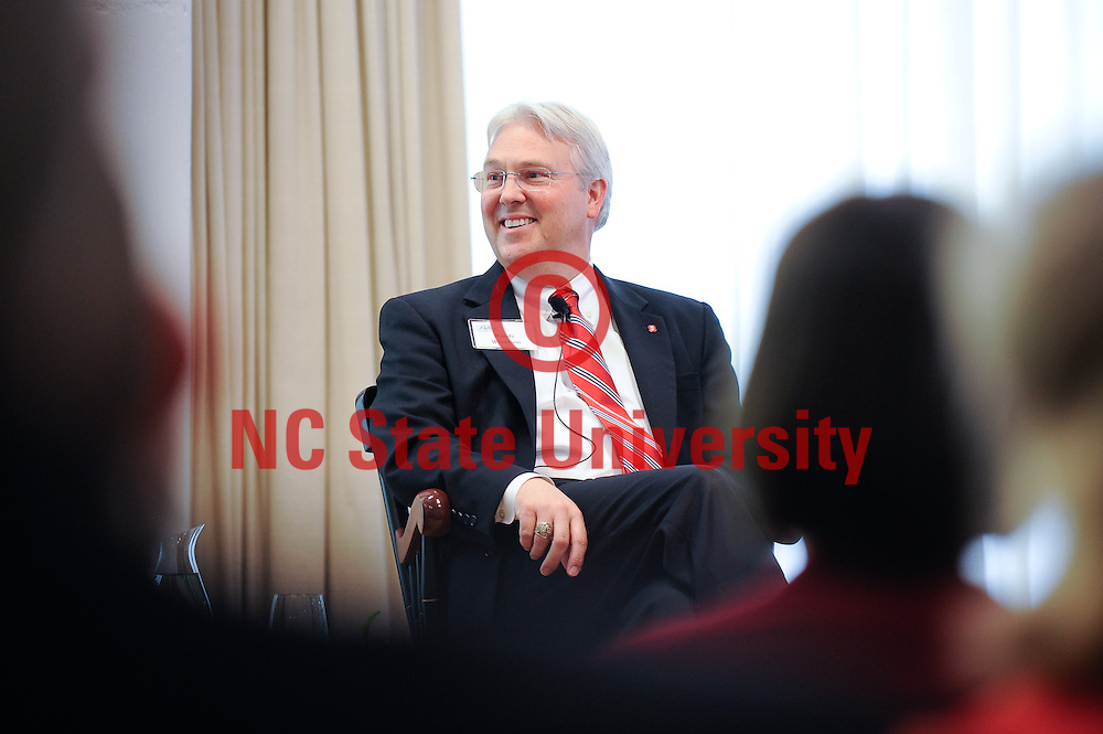 Chancellor Randy Woodson smiles as he listens at a Pullen Society event.