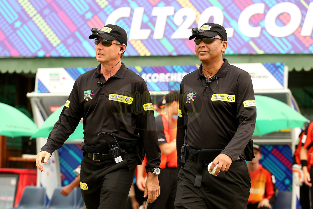 Standing umpires S Ravi and Ron Tucker walking out onto the field during match 4 of the Oppo Champions League Twenty20 between the Dolphins and the Perth Scorchers held at the Punjab Cricket Association Stadium, Mohali, India on the 20th September 2014. Photo by:  Jacques Rossouw / Sportzpics/ CLT20<br /> <br /> <br /> Image use is subject to the terms and conditions as laid out by the BCCI/ CLT20.  The terms and conditions can be downloaded here:<br /> <br /> http://sportzpics.photoshelter.com/gallery/CLT20-Image-Terms-and-Conditions-2014/G0000IfNJn535VPU/C0000QhhKadWcjYs