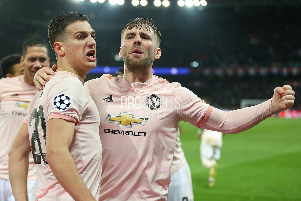 Manchester United Defender Luke Shaw celebrates with Manchester United Defender Diogo Dalot during the Champions League Round of 16 2nd leg match between Paris Saint-Germain and Manchester United at Parc des Princes, Paris, France on 6 March 2019.