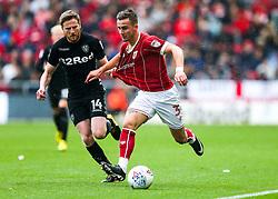 Joe Bryan of Bristol City is challenged by Eunan O'Kane of Leeds United - Rogan/JMP - 21/10/2017 - Ashton Gate Stadium - Bristol, England - Bristol City v Leeds United - Sky Bet Championship.
