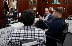 The Duke of Cambridge speaks to Dean Hamilton (right) and Paul Richardson as he meets members of the Lion Barbers Collective, who are raising awareness of suicide prevention through a programme called BarbersTalk, during a visit to Pall Mall Barbers in Paddington, west London.