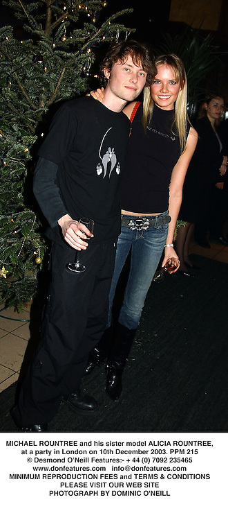 MICHAEL ROUNTREE and his sister model ALICIA ROUNTREE, at a party in London on 10th December 2003.PPM 215
