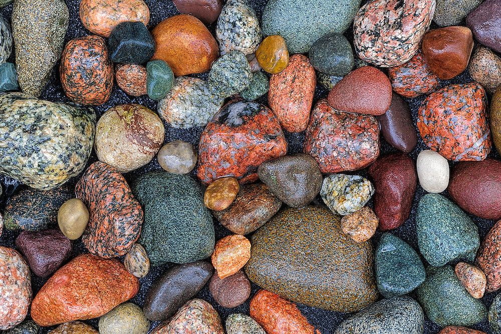 Wet Lake Michigan rock close up, granite and sandstone in a variety of colors.