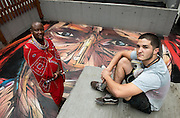 "Rooftop painting by Parisian street artist Alexandre Monteiro aka Hopare (R) of Masai warrior Daniel Ole Sambu (L)<br /> Street art in Hong Kong ahead of the The ""Hope for Wildlife"" Gala Dinner painted to raise awareness for the plight of endangered animals the world over.<br /> Sheung Wan Hong Kong<br /> 10th November 2016. Photo by Jayne Russell"