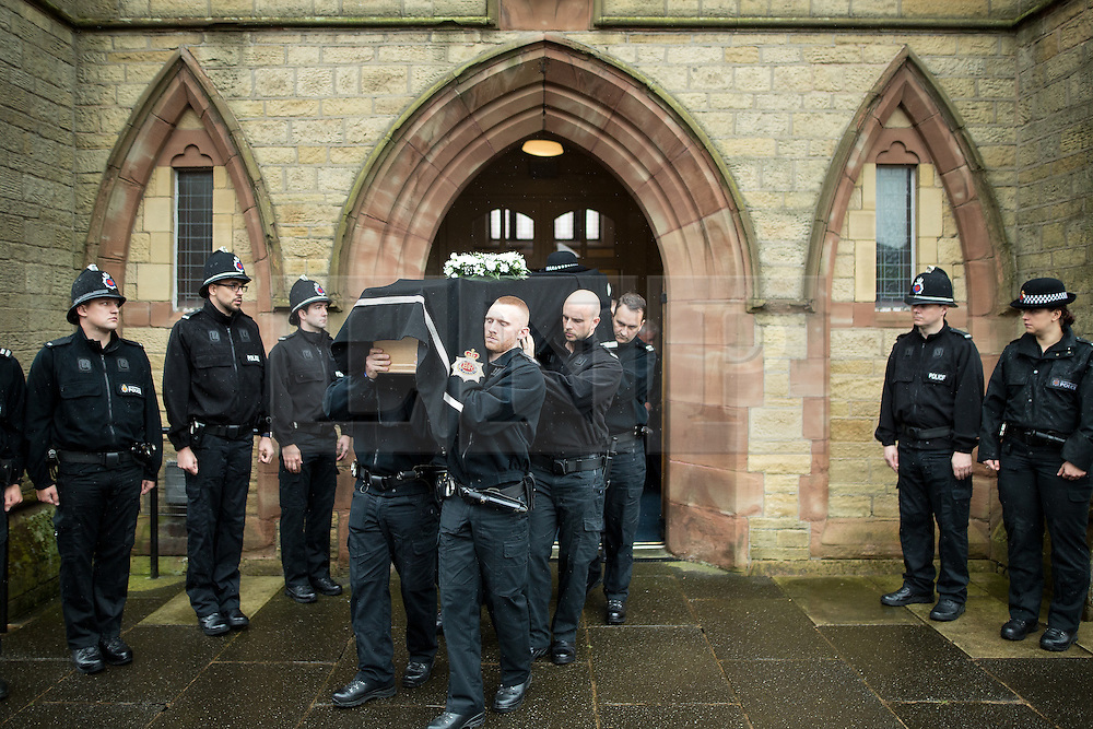 © Licensed to London News Pictures . 15/07/2016 . Bolton , UK . The coffin is carried from the church after the service .  The funeral of Special Constable Samantha Derbyshire at St Mary's RC Church in Horwich , Bolton. Derbyshire was struck and killed by an HGV on the M61 motorway following a collision , in the early hours of Monday 11th July 2016 . Photo credit : Joel Goodman/LNP
