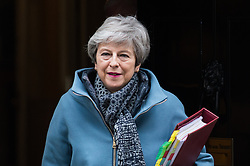 March 27, 2019 - London, England, United Kingdom - British Prime Minister Theresa May leaves 10 Downing Street in central London for the weekly PMQ session in the House of Commons on 27 March, 2019. Today, MPs will hold a series of indicative votes on alternative Brexit plans following a government defeat in the Commons as parliamentarians took control of the order paper. (Credit Image: © Wiktor Szymanowicz/NurPhoto via ZUMA Press)
