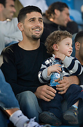 Israeli soccer star Abbas Suan, holds his son,  Mohammad, 2, while watching his team play a match, Ramat Gan, Israel, Jan. 31, 2006. Suan was taking some time off from playing due to an injury and a foul being called against him in a previous game. Suan, an Israeli-Arab, still faces criticism and racism resulting from the unsettled conflict between the Israelis and Palestinians.
