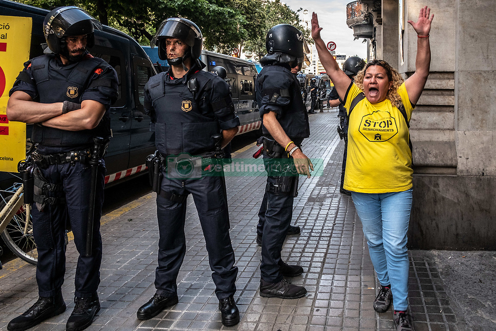 June 15, 2018 - Barcelona, Catalonia, Spain - A public housing activist goes out on her own after being identified inside the Department of Economics. Activists have occupied the Department of Economy to negotiate the cancellation of an auction of 47 homes that the Generalitat de Catalunya has inherited from untested inheritances. Public housing groups want these properties to go to public management to alleviate the lack of public housing. Finally the Catalan police, Mossos d'Esquadra, has evicted the activists from the Economy offices. (Credit Image: © Paco Freire/SOPA Images via ZUMA Wire)