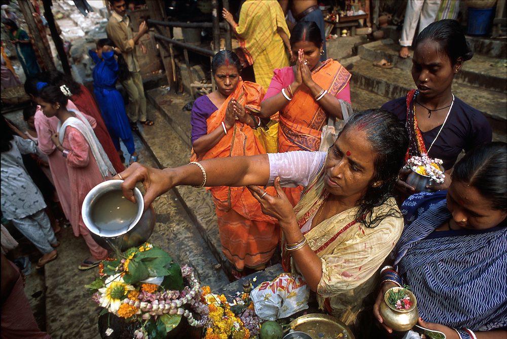 INDIA: Calcutta.A puja is performed during Kumbh Mela, along the bank of the Hooghli River, which feeds into the Holy ganges