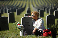 Tampa resident Susan Guttke pays her respects on Veteran's Day at the grave site of her daughter Dana Leigh Guttke, who served in the U.S. Navy during the Persian Gulf War, at the Florida National Cemetery in Bushnell, FL, November 11 2008.