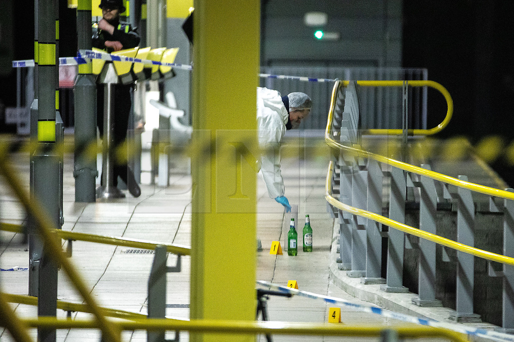 © Licensed to London News Pictures . FILE PICTURE DATED 01/01/2019 of forensic scenes of crime examiners working on a platform at Victoria Station in Manchester as Mahdi Mohamud is due to appear at Manchester Crown Court today (Tuesday 26 November 2019) charged  with 3 counts of attempted murder and 1 count contrary to Section 58 (1) (a), TACT 2000 which relates to the possession of a document or record likely to be useful to a person committing or preparing an act of terrorism . On the evening of 31st December 2018 , as thousands headed in to Manchester City Centre to watch New Years Day fireworks , three people including a British Transport Police Officer were stabbed and a man was tasered on a Metrolink platform of Victoria Train Station in Manchester . Photo credit : Joel Goodman/LNP