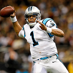 December 30, 2012; New Orleans, LA, USA; Carolina Panthers quarterback Cam Newton (1) throws against the New Orleans Saints during the second half of a game at the Mercedes-Benz Superdome. The Panthers defeated the Saints 44-38. Mandatory Credit: Derick E. Hingle-USA TODAY Sports