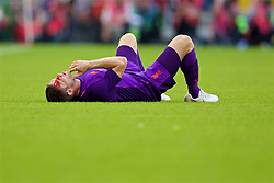 DUBLIN, REPUBLIC OF IRELAND - Saturday, August 4, 2018: Liverpool's James Milner lies injured with blood pouring from from his head after a clash with Napoli's Mário Rui during the preseason friendly match between SSC Napoli and Liverpool FC at Landsdowne Road. (Pic by David Rawcliffe/Propaganda)