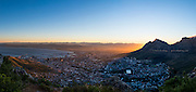 Cape Town city bowl at sunrise. The sun is rising behind Devil's Peak, part of the Table Mountain National Park. The photo was taken from Lion's Head.