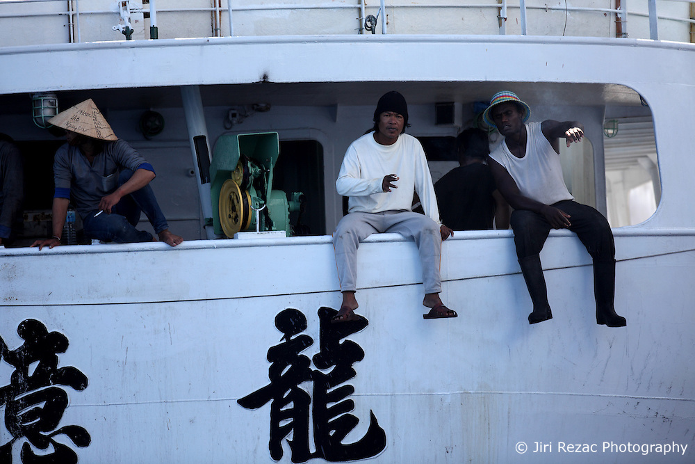 INDIAN OCEAN 26APR13 - Asian crewmembers of the Taiwanese longliner Yi Long No 202 during tuna transhipment on the high seas in the Indian Ocean.<br /> <br /> The Greenpeace ship Esperanza is on patrol in the Indian Ocean documenting fishing activities.<br /> <br /> <br /> <br /> jre/Photo by Jiri Rezac / Greenpeace