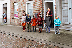 Kids on the roadside in Tielt wait for the peloton to speed by- Dwars door Vlaanderen 2016, a 103km road race from Tielt to Waregem, on March 23rd, 2016 in Flanders, Netherlands.