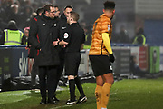 Referee C Pollard has a word with Crewe Alexandra manager David Artell during the EFL Sky Bet League 2 match between Macclesfield Town and Crewe Alexandra at Moss Rose, Macclesfield, United Kingdom on 21 January 2020.