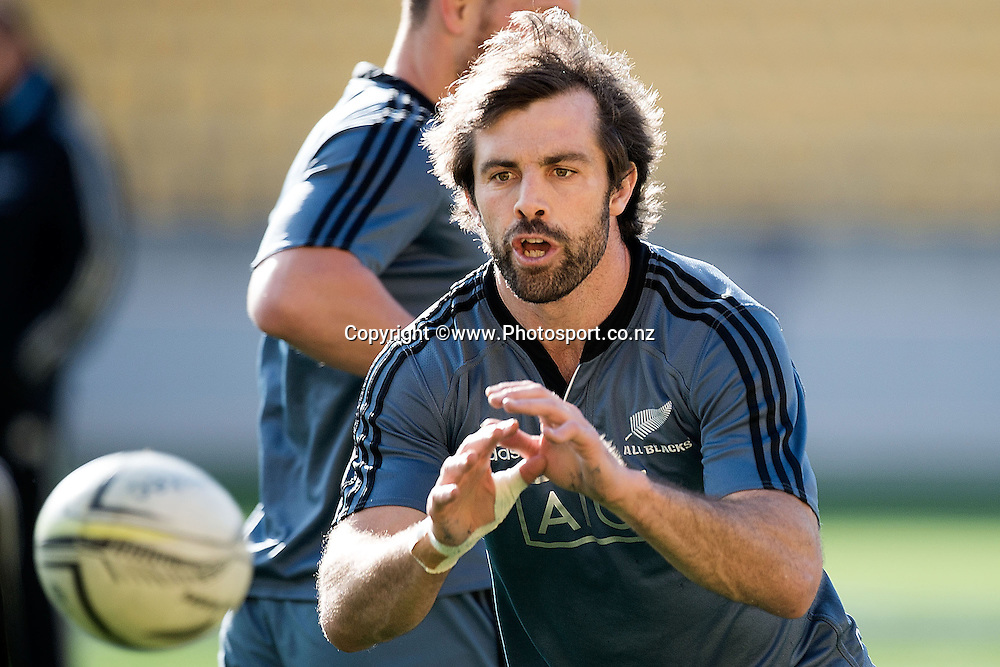 Conrad Smith of the All Blacks makes a pass during a All Blacks Training session at the Westpac Stadium in Wellington on Thursday the 11th of September 2014. Photo by Marty Melville/www.Photosport.co.nz