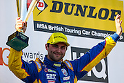 Andrew Jordan celebrates second place during the Dunlop MSA British Touring Car Championship at Oulton Park, Budworth, Cheshire, United Kingdom on 7th June 2015. Photo by Aaron Lupton.
