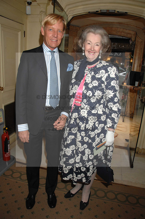 RAINE, COUNTESS SPENCER and PHILIP VERGEYLEN DE MAESENEER at a reception to celebrate the launch of Prince Dimitri of Yugoslavia's one-of-a-kind jeweleery collection held at Partridge Fine Art, 144-146 New Bond Street, London on 11th June 2008.<br /><br />NON EXCLUSIVE - WORLD RIGHTS