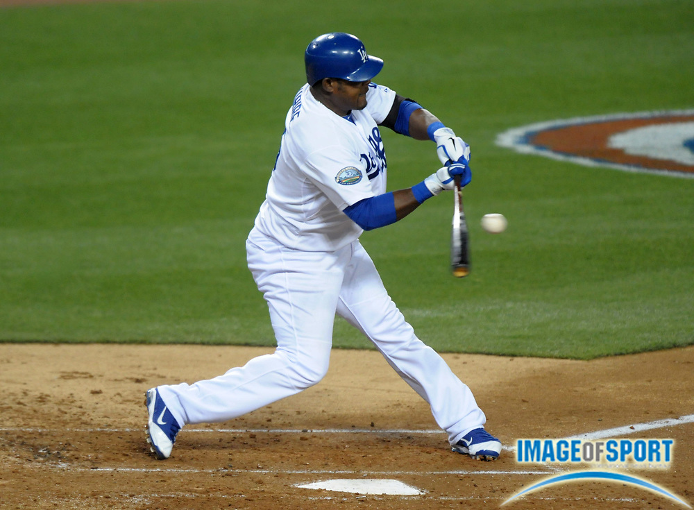 Apr 11, 2012; Los Angeles, CA, USA; Los Angeles Dodgers third baseman Juan Uribe (5) bats during the game against the Pittsburgh Pirates at Dodger Stadium.