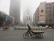Rickshaw in fog. Dhaka, Bangladesh.