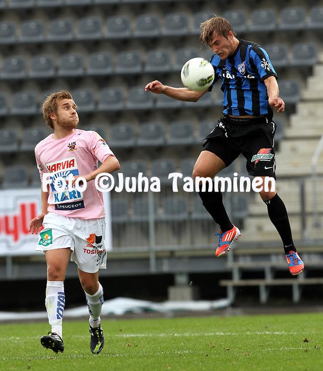 15.7.2012, Veritas stadion (Kupittaa), Turku..Veikkausliiga 2012..FC Inter Turku - JJK Jyv?skyl?..Mika Ojala (Inter) v Jani Virtanen (JJK)..