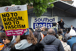 Southall, UK. 27th April 2019. Suresh Grover of Southall Resists addresses members of the local community and supporters at a rally outside Southall Town Hall to honour the memories of Gurdip Singh Chaggar and Blair Peach on the 40th anniversary of their deaths. Gurdip Singh Chaggar, a young Asian boy, was the victim of a racially motivated attack whilst Blair Peach, a teacher, was killed by the Metropolitan Police's Special Patrol Group during a peaceful march against a National Front demonstration.