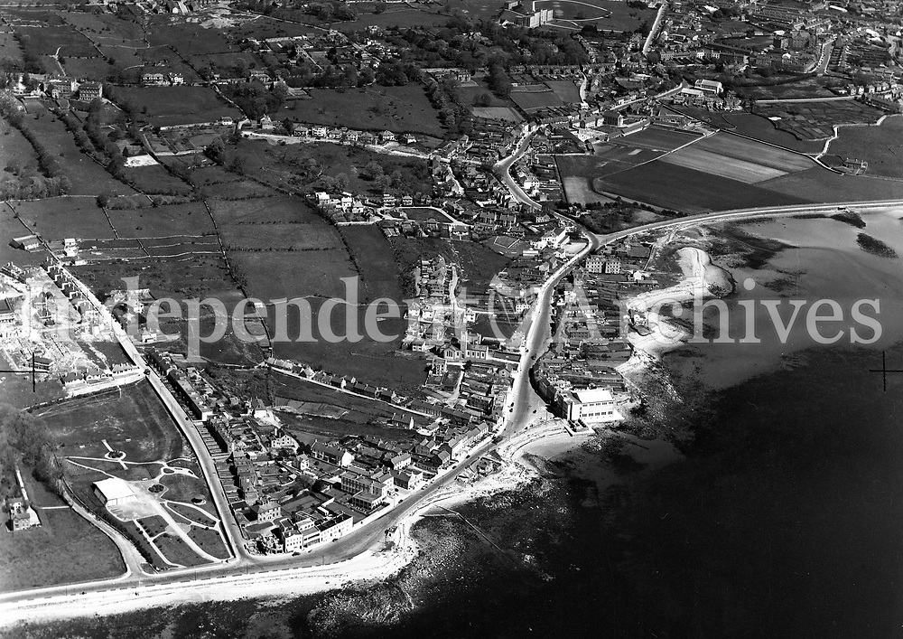 A394 Salthill.   19/11/54. (Part of the Independent Newspapers Ireland/NLI collection.)<br /> <br /> <br /> These aerial views of Ireland from the Morgan Collection were taken during the mid-1950's, comprising medium and low altitude black-and-white birds-eye views of places and events, many of which were commissioned by clients. From 1951 to 1958 a different aerial picture was published each Friday in the Irish Independent in a series called, 'Views from the Air'.The photographer was Alexander 'Monkey' Campbell Morgan (1919-1958). Born in London and part of the Royal Artillery Air Corps, on leaving the army he started Aerophotos in Ireland. He was killed when, on business, his plane crashed flying from Shannon.