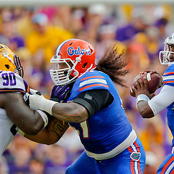 Oct 12, 2013; Baton Rouge, LA, USA; Florida Gators offensive linesman Jon Halapio (67) blocks against LSU Tigers defensive tackle Anthony Johnson (90) during the second half of a game at Tiger Stadium. LSU defeated Florida 17-6. Mandatory Credit: Derick E. Hingle-USA TODAY Sports