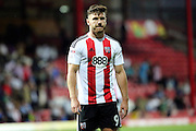 Brentford forward Scott Hogan (9) on his own during the EFL Sky Bet Championship match between Brentford and Nottingham Forest at Griffin Park, London, England on 16 August 2016. Photo by Matthew Redman.