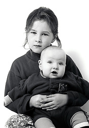 Studio portrait of girl & baby UK 1990s