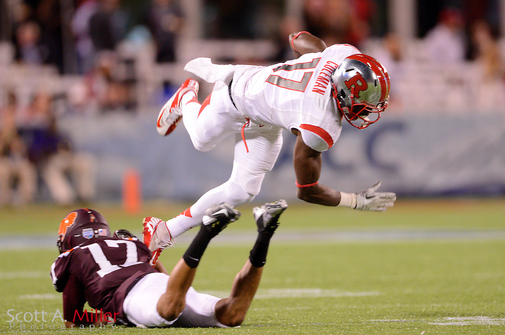 Rutgers Scarlet Knights wide receiver Brandon Coleman (17) goes airborne after being tackled by Virginia Tech Hokies cornerback Kyle Fuller (17) during the Russell Athletic Bowl on Dec 28, 2012 in Orlando, Florida. ...©2012 Scott A. Miller..
