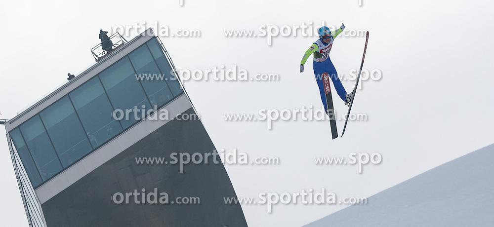 03.01.2015, Bergisel Schanze, Innsbruck, AUT, FIS Ski Sprung Weltcup, 63. Vierschanzentournee, Innsbruck, Training, im Bild Marat Zhaparov (EST) // Marat Zhaparov of Estonia soars through the air during a training session for the 63rd Four Hills Tournament of FIS Ski Jumping World Cup at the Bergisel Schanze in Innsbruck, Austria on 2015/01/03. EXPA Pictures © 2015, PhotoCredit: EXPA/ Jakob Gruber