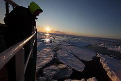 ATLANTIC OCEAN ABOARD ARCTIC SUNRISE 31MAY11 - Cameraman Mario Poeta of Italy aboard the Greenpeace Ship Arctic Sunrise in the Arctic sea ice in the Labrador Sea.....jre/Photo by Jiri Rezac / Greenpeace