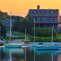 Cape Cod Quissett Yacht Club framed by the beautiful sunset light in Falmouth, Massachusetts.<br />