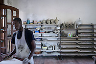 Aji is 17 years old; he comes from Senegal. Aji is an unaccompanied minor who enjoys of an UE program for work and training. Ateliers were created to teach the refugees artisanal techniques; that's why Aji met Franco (52 yo), a potter master who re-opened a workshop in the upper Riace. Now Aji is learning from Franco the traditional and local techniques; taking know-how to work with pottery in the future. RIACE (ITALY) 03/08/16