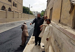 June 12, 2017 - Pakistan - KARACHI, PAKISTAN, JUN 12: Heavy machineries and labours busy in construction work of .carpeting road under the supervision of Union Council-26 Chairman Qasir Imtiaz, Telegraph .Mosque road near Pakistan Chowk in Karachi on Monday, June 12, 2017. (Credit Image: © PPI via ZUMA Wire)
