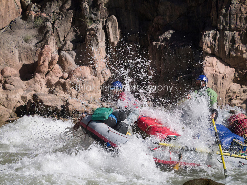 A raft crashes through some whitewater on the Colorado River, Grand Canyon, AZ