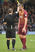 Bradford City Forward, James Hanson shown a yellow card, booked during the The FA Cup third round match between Bury and Bradford City at Gigg Lane, Bury, England on 9 January 2016. Photo by Mark Pollitt.