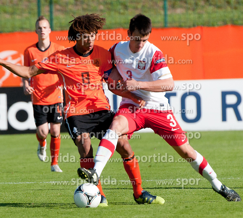 Riechedly Bazoer of Poland vs Nathan Ake of Netherlands during the UEFA European Under-17 Championship Group A match between Netherlands and Poland  on May 10, 2012 in Lendava, Slovenia. (Photo by Erik Kavas/ Sportida.com)