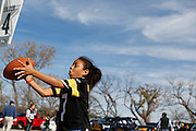 Kyleigh Oree, 8, plays catch with her friend in parking lot 4 before the Cowboys and Steelers game at Cowboys Stadium in Arlington, Texas, on December 16, 2012.  (Stan Olszewski/The Dallas Morning News)