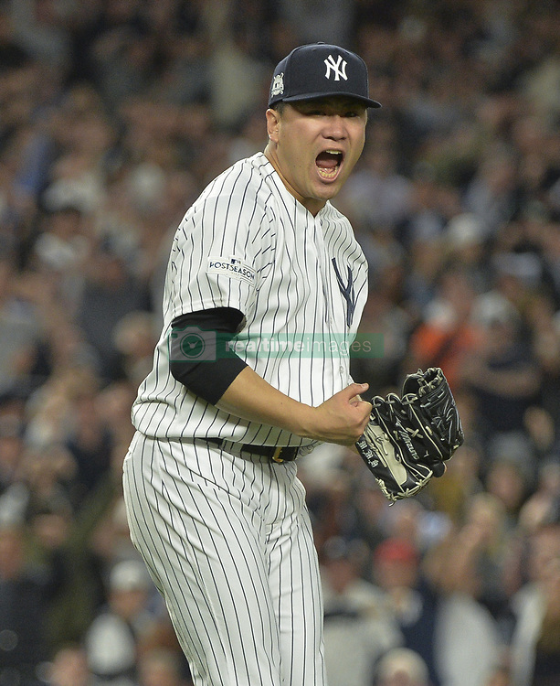 October 18, 2017 - Bronx, NY, USA - New York Yankees starting pitcher Masahiro Tanaka reacts after striking out the Houston Astros' Josh Reddick to end the fifth inning in Game 5 of the American League Championship Series at Yankee Stadium in New York on Wednesday, Oct. 18, 2017. (Credit Image: © Howard Simmons/TNS via ZUMA Wire)
